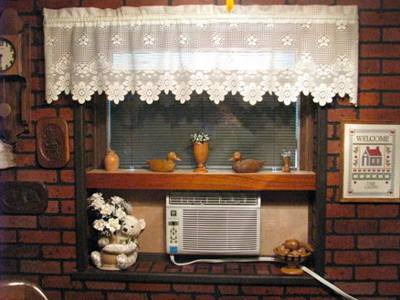 Enhancement Shelf for a Window Air Conditioner