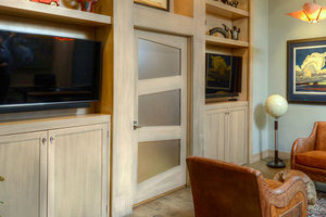 Custom Trapezoid Door in a built in bookshelf