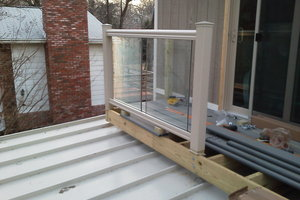 1:12 pitch roof with balcany and glass railing