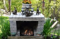 adding an outdoor fireplace